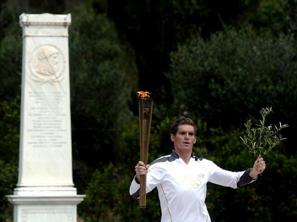 Spyros Gianniotis started the Olympic torch relay at the ancient site of Olympia earlier this month. Greece hasn't won an Olympic medal in swimming since 1896 — something Gianniotis hopes to change in London.