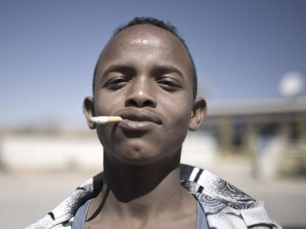 A man smokes outside a voter registration center in Burao, Somaliland.
