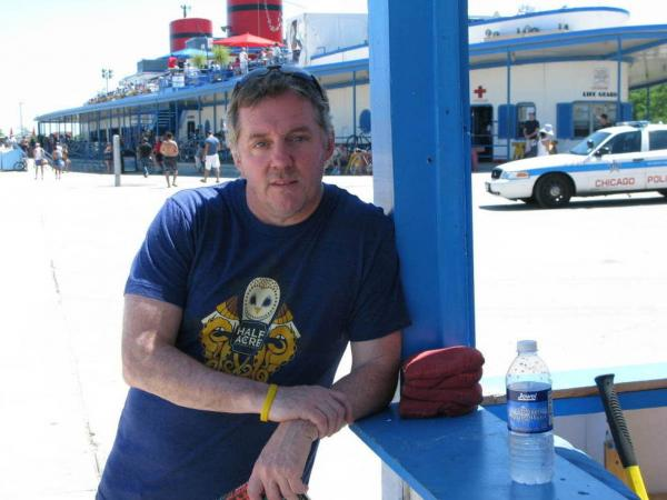 Michael Harvey poses in front of the Castaways Bar and Grill at Chicago's North Avenue Beach. Investigator Kelly often visits the lakefront to clear his mind on the its running paths.