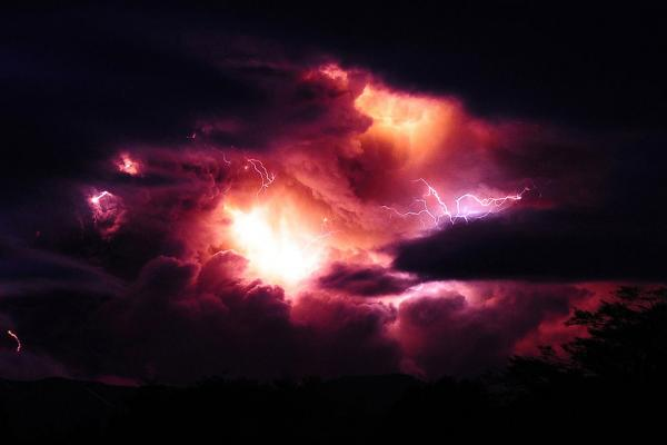 Columns of smoke and volcanic lightning are seen over the Puyehue volcano in Chile Sunday after a spectacular eruption a day earlier.