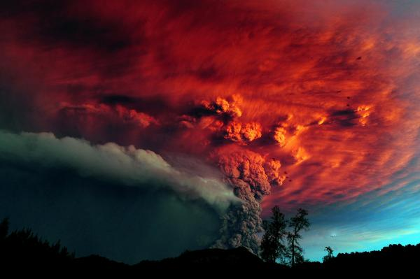 A cloud of ash from the volcano billows over Osorno in southern Chile on Sunday. The first eruption in half a century prompted the evacuations of thousands of people.