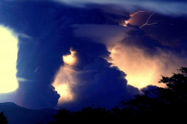 Ash and lightning sparked by the eruption make for a dramatic display in the skies. The eruption has disrupted international air travel.