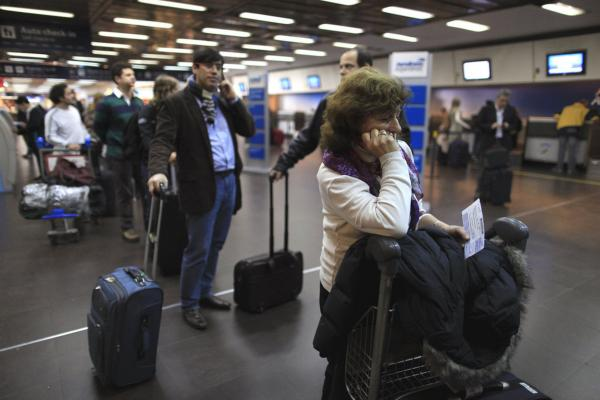 Stranded passengers line up at an Aerolineas Argentinas desk on Tuesday, June 7. But Tuesday afternoon the airline said it had ceased all domestic and international flights until further notice.