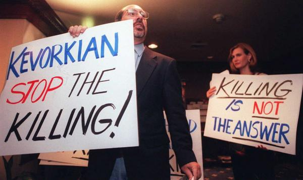 Protesters appeared at the National Press Club in Washington, D.C.,  in July 1996, as Kevorkian addressed a luncheon there.