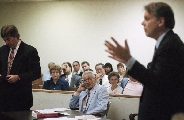 Michigan at the time had no law against assisted suicide; the Legislature wrote one in response to Kevorkian. He also was stripped of his medical license. Pictured here in 1993, Kevorkian (center) sits in a Detroit courtroom, charged with assisted suicide.