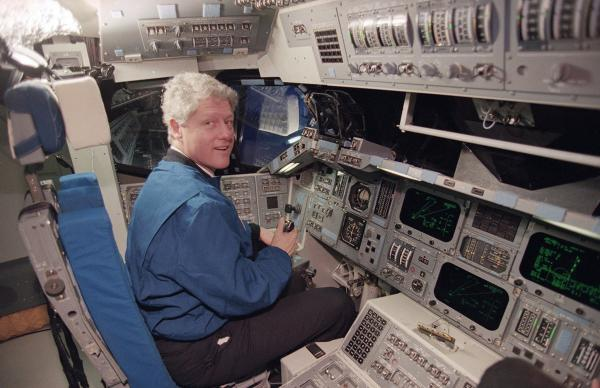 President Bill Clinton sits at the controls of a space shuttle flight simulator at the Johnson Space Center in Houston in February 1994.