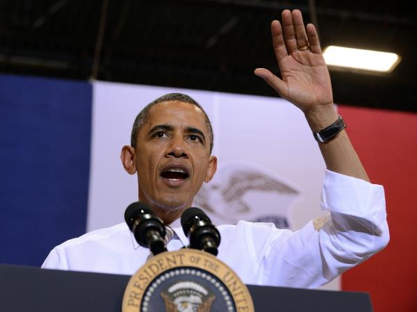 President Barack Obama waves after speaking at the TPI Composites, a wind blade manufacturer, in Newton, Iowa, on May 24, 2012.