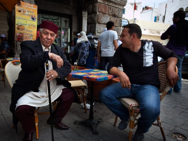 Since the revolution last year, Tunisians have had greater freedom to express their opinions on political and social issues. But the rise of Islamist groups has made religion a more sensitive topic. Here, two men chat at a cafe in the capital Tunis.