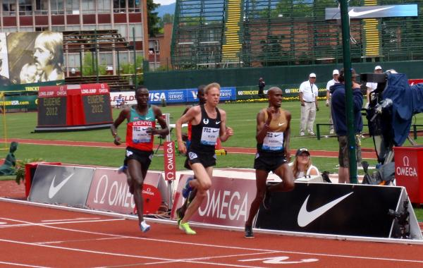 Portland's Galen Rupp (center, all-black uniform) was pleased by his top three finish in the 5000 meters. By Tom Banse.