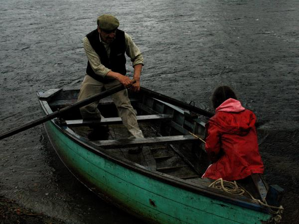 Lalo Sandoval and his granddaughter Sara row the Baker River in Chile. Many of the residents of the Patagonia river valleys still travel via ox cart and small boat.