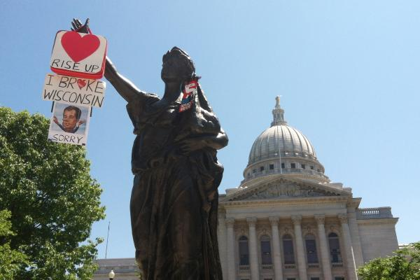 "The statue, ""Forward"", circa 1893, stands in front of the capitol building. ""Forward"" is the state motto, and both campaigns have been using that motion in their ads.<br /><br />"