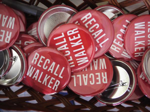 """Recall Walker"" buttons at the Rock County Democratic Party Headquarters Monday in Janesville, Wis."