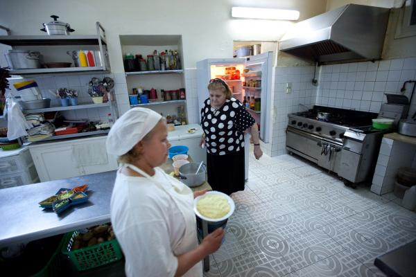 LaLoush's mother, Lily, and chef Hadia Ben Mahmoud prepare dinner in the family restaurant, Mamy Lily.