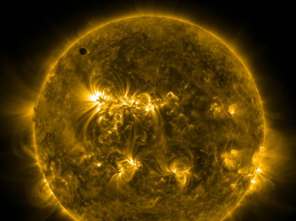 Handout image courtesy of NASA shows the planet Venus at the start of its transit of the Sun, on June 5. One of the rarest astronomical events occurs on Tuesday and Wednesday when Venus passes directly between the sun and Earth, a transit that won't occur again until 2117.