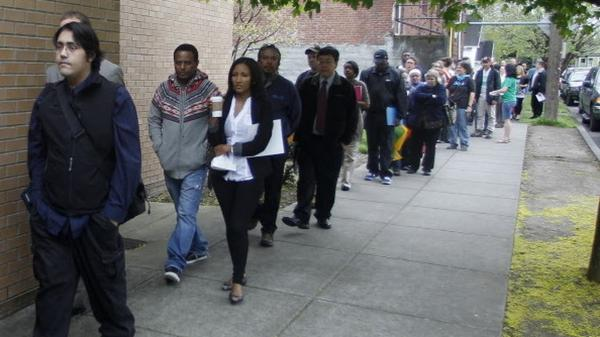 Job seekers lined up at a jobs fair in Portland, Ore., earlier this year.