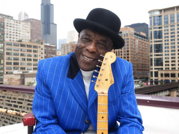 """I didn't learn nothing from a book,"" Buddy Guy tells NPR's Neal Conan. ""I learned by ... being quiet, keep your ears open and listen."""