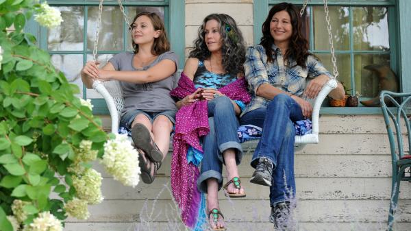 A big-city lawyer (Catherine Keener, right) must adjust to the hippie lifestyle when she and her daughter (Elizabeth Olsen, left) go to Woodstock to visit her mother (Jane Fonda) in <em>Peace</em>,<em> Love & </em><em>Misunderstanding</em>.