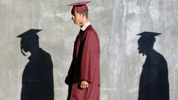 Columbia High School graduates walk to their commencement ceremony in Nampa, Idaho. A new Rutgers University study says nearly half of recent high school graduates are still looking for full-time work.