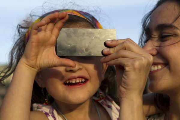 "A ""little scientist"" watches the transit of Venus across the face of the sun on June 5, 2012, in Medellin, Colombia."