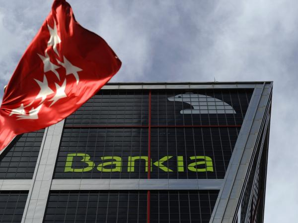 A bunch of troubled little Spanish banks got together and became Bankia, a troubled big Spanish bank.