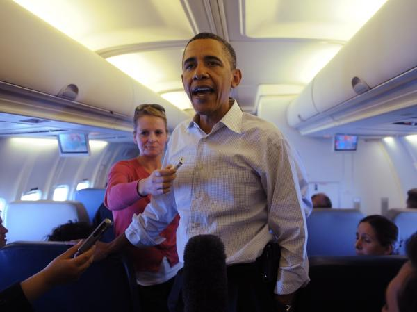 President Barack Obama speaks with traveling journalists on board Air Force One on April 28, 2010. His administration faces criticism for a spate of recent intelligence leaks.