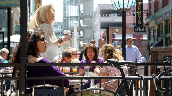 Outdoor dining spaces are filled on a warm spring day on E. 4th Street in downtown Cleveland. Like many former industrial towns, downtown Cleveland has seen a revival in the last few years to become an urban hotspot.