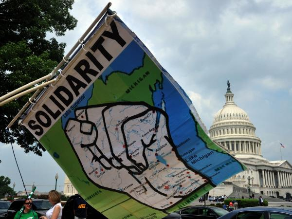 A banner showing the state of Wisconsin in the shape of a fist for union solidarity is seen July 28, 2011 during a protest on Capitol Hill. Last week, Wisconsin Governor Scott Walker survived a recall attempt pushed by the state's public sector union members, who are upset over the Governor's decision to eliminate collective bargaining rights.