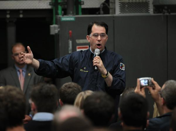 Wisconsin Governor Scott Walker speaks to workers at Quad Graphics during a campaign stop on June 1, 2012 in Sussex, Wisconsin. Last Tuesday, Walker survived a recall attempt largely supported by public sector union members angry over his decision to curtail collective bargaining rights.
