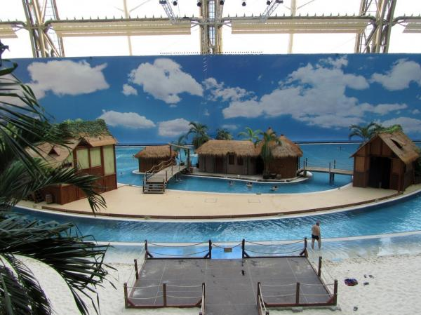At Berlin's Tropical Islands, sandy beaches line the tropical sea, and a backdrop of a sky makes visitors forget they're inside a dome...almost.