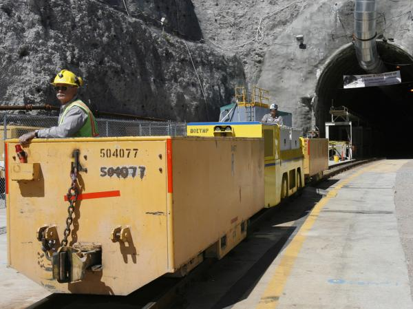 Pete Vavricka conducts an underground train from the entrance of Yucca Mountain in Nevada in 2006. President Obama canceled the planned nuclear waste repository there in 2009.