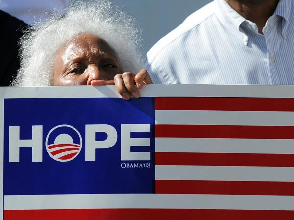 An elderly supporter of President Barack Obama joins others to cheer near a house where Obama held a campaign event in Los Angeles, California on June 7. Despite recent campaign gaffes by the President many have described as self-inflicted wounds, opinion polls have remained relatively steady.