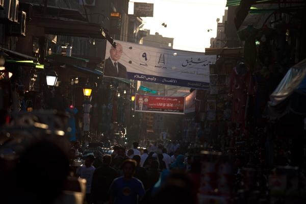 Scenes from the Khan el-Khalili market in downtown Cairo. Election posters for the two candidates in Egypt's upcoming runoff election can be seen hanging above the street.