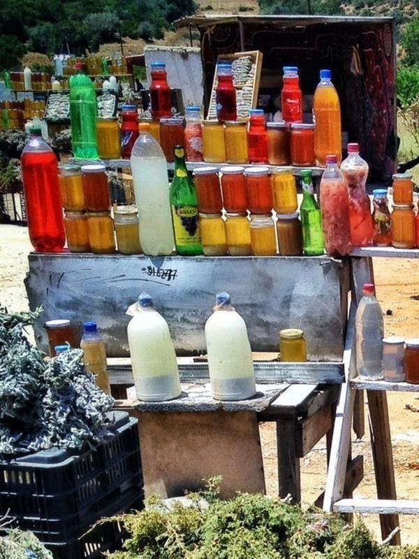 Jars of honey and bunches of herbs at a roadside stall near Libya's Green Mountains.