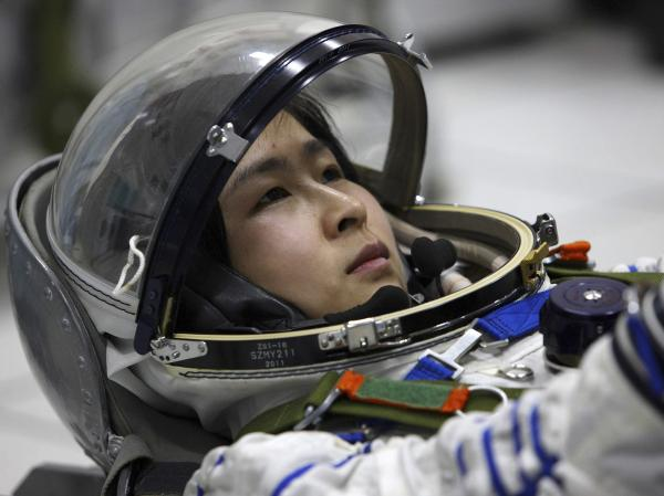 Liu Yang, China's first female astronaut, trains in Beijing in April, 2012.