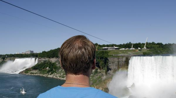 Nik Wallenda looks at the tightrope cable in Niagara Falls, Canada on Wednesday.