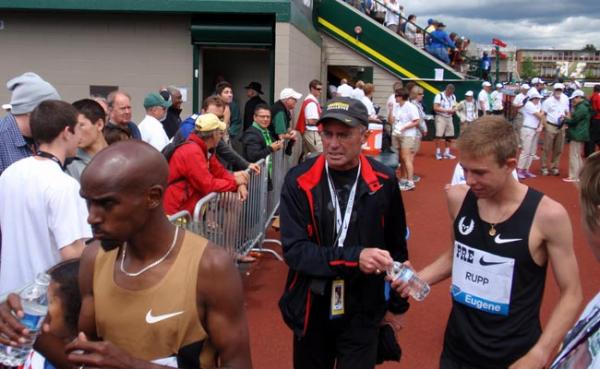 Coach Alberto Salazar congratulates Nike Oregon Project teammates Mo Farah (front left) and Galen Rupp (right) after a June 2nd race in Eugene. Photo by Tom Banse