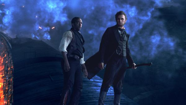 Abraham Lincoln (Benjamin Walker) and Will Johnson (Anthony Mackie) in one of the slick action sequences from <em>Abraham Lincoln: Vampire Hunter</em>. Lincoln's weapon of choice in the film is a silver-plated ax.