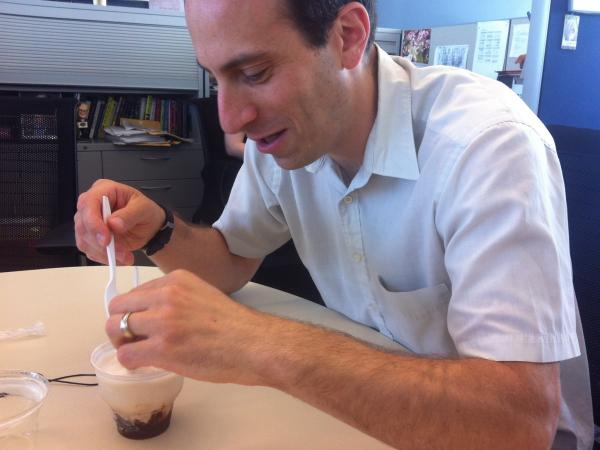 Grosz uses a spoon to defend himself from the bacon sundae.