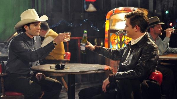 In <em>The Last Ride, </em>Silas (Jesse James, right) is hired to drive Hank Williams (Henry Thomas) to his New Year's<em> </em>gigs and must learn to stand up to the country singer's hectoring behavior.