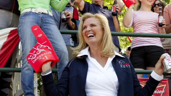 "Ann Romney, wife of Republican presidential candidate Mitt Romney, wears a ""Dressage is no. 1"" foam finger at a competition on Saturday. Romney's horse, Rafalca, qualified for the 2012 Olympic dressage team."