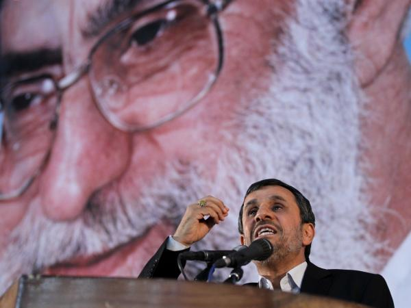 Iranian President Mahmoud Ahmadinejad delivers his speech under a portrait of Iran's supreme leader, Ayatollah Ali Khamenei on the eve of the 23rd anniversary of the Islamic revolutionary leader, Ayatollah Ruhollah Khomeini's death at his mausoleum in a suburb of Tehran on June 2.