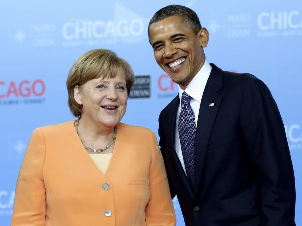 President Barack Obama greets German Chancellor Angela Merkel as she arrives at the NATO summit on May 20 in Chicago, Illinois. Many economists and politicians worry a sputtering European economy could hamper an already fragile American recovery.