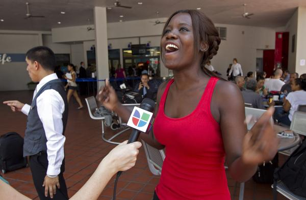 Niouseline St. Jean, originally from Turks and Caicos Islands who lives in the U.S. illegally, reacts as she talks to the media about the new immigration ruling for students at the Miami Dade Community College in Miami last Friday.