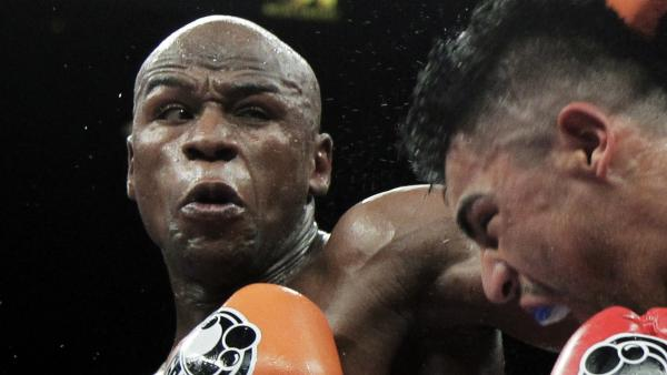 Floyd Mayweather Jr., left, punching Victor Ortiz during their WBC welterweight title fight in Las Vegas in September.
