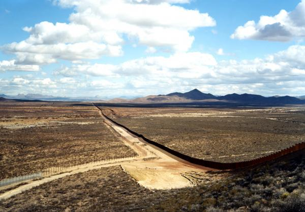 This photograph is included in an exhibition currently at the San Francisco Museum of Modern Art, <em>Photography In Mexico.</em> (Border fence, near Naco, Ariz., 2010)