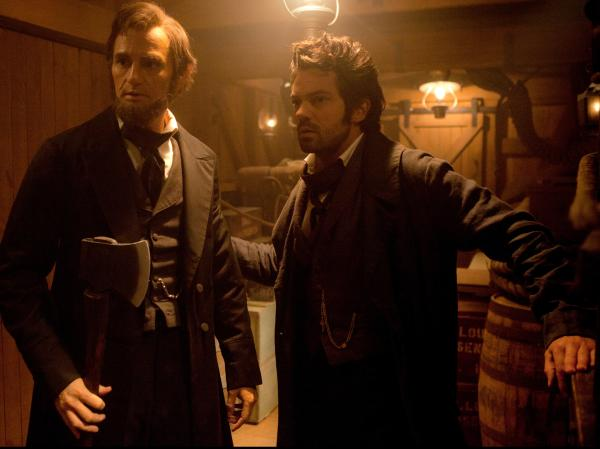 Abraham Lincoln with Henry Sturges (Dominic Cooper), a friendly member of the undead who trains Lincoln as a vampire hunter.