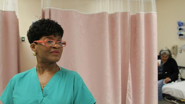 Certified Nurse Assistant Cynthia Johnson handles some of the intake at Highland Hospital's ER, featured in <em>The Waiting Room</em>.