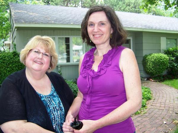 Kathleen Flenniken, right, and her childhood best friend Carolyn Fazzari near Flenniken's family's home in Richland, Wash. Photo by Anna King