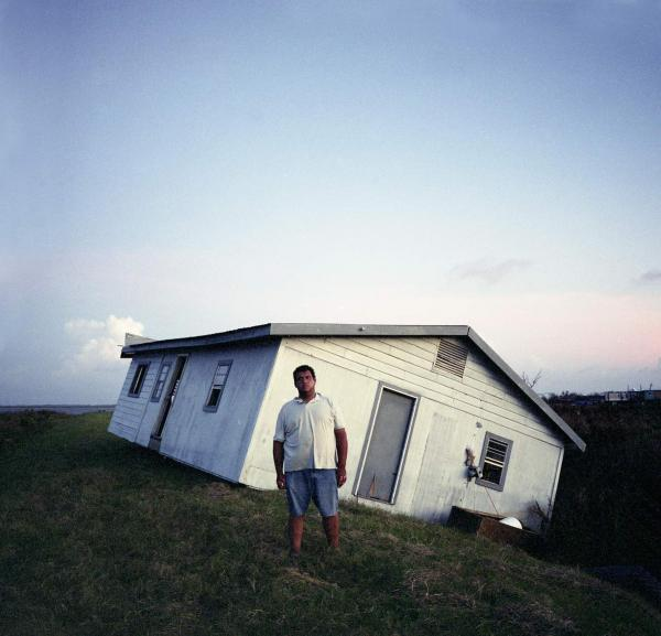 <em>Walter Dardar Jr., with His Father's House after Hurricanes Gustav and Ike, Isle de Jean Charles, Louisiana,</em> 2008