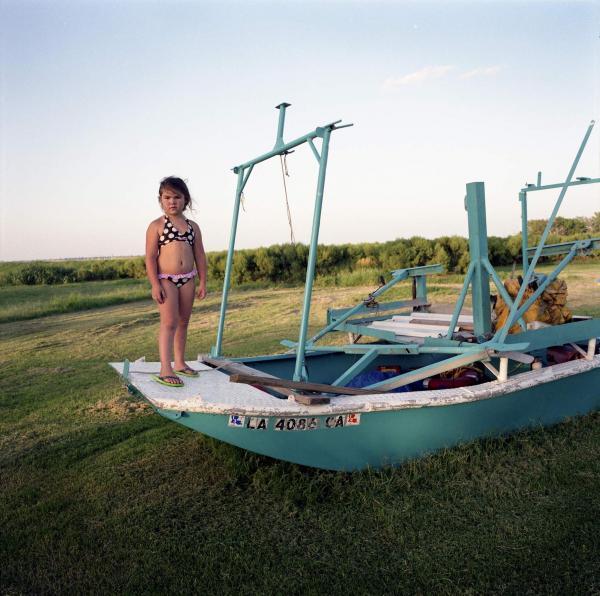 <em>Kierstin Guidry with Hilton Chaisson's Boat, Isle de Jean Charles, Louisiana,</em> 2010